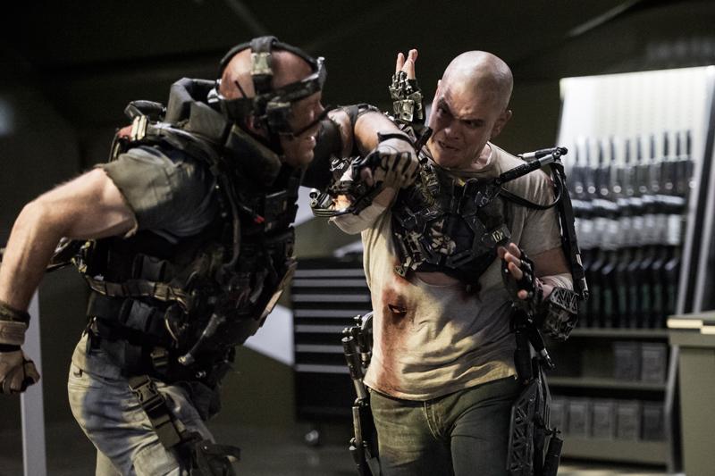 Matt Damon slugging it out rockin' the cue ball in Elysium.