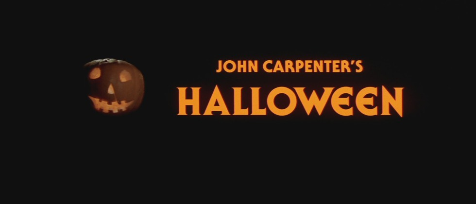 The Titl-card for the film utilises the black background to accentuate the orange text and the pumpkin.