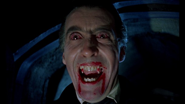 The famed fangs of the vampire, bloodied and revealing a wicked smile,