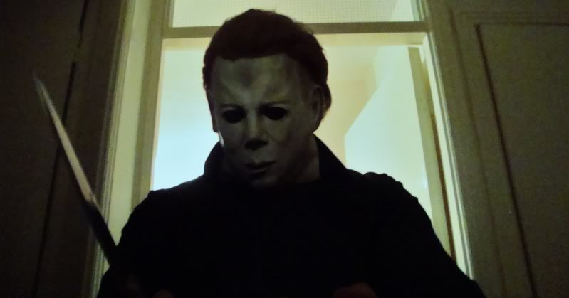 The evil Michael Myers looms over another victim with his trademark mask and carving knife!