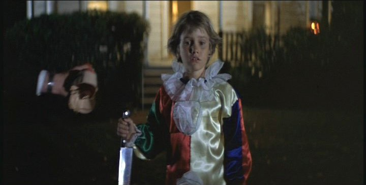 The mask is removed after a murderous opening to the film, which reveals a child as the killer!