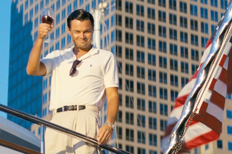 Bottoms up! Jordan Belfort living the American dream and toasting the FBI with a cheeky glass of Chateau Margaux.